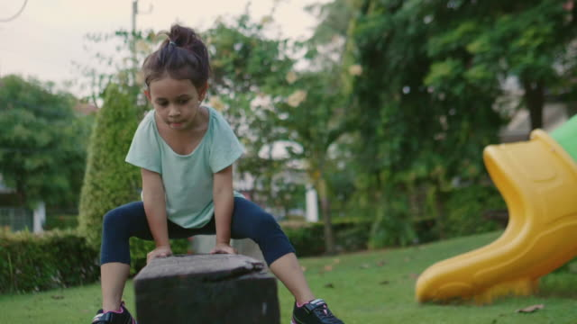 young girl balances in garden. - balance stock videos & royalty-free footage