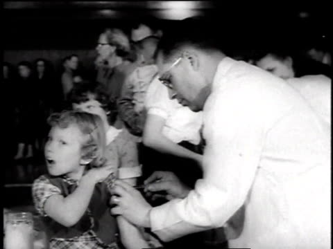 young girl being injected with salk vaccine for polio while others wait in line / kansas usa - polio stock videos & royalty-free footage