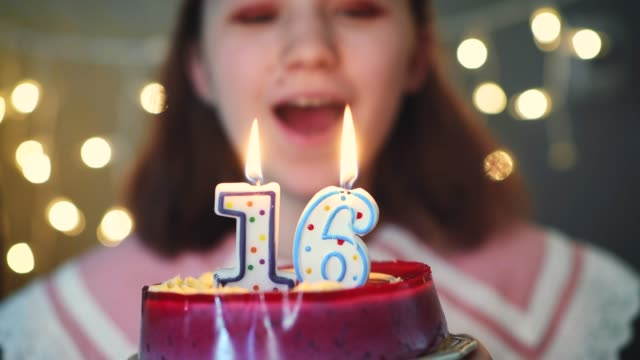 young girl blowing candles on birthday cake - 16 17 years stock videos & royalty-free footage