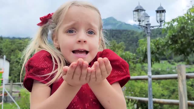 young girl blowing confetti - blue eyes stock videos & royalty-free footage