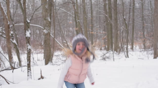 young girl catching snowflakes on tongue snow covered trail - mitten stock videos and b-roll footage