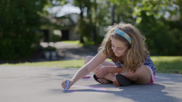 ls young girl chooses different colors of chalk to draw with. - chalk art equipment stock videos & royalty-free footage