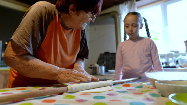 young girl cooking with her grandmother - rolling pin stock videos & royalty-free footage