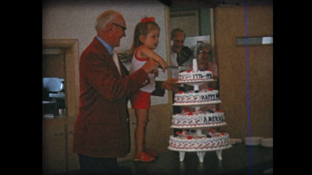 1976 young girl cuts bicentennial birthday cake