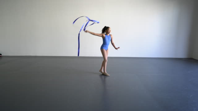 ws young girl dancing with a ribbon in a dance studio - rhythm stock videos and b-roll footage