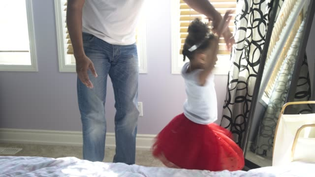 young girl dancing with her father. - dressing up stock videos & royalty-free footage