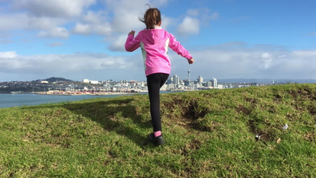 Young girl discovering Auckland skyline