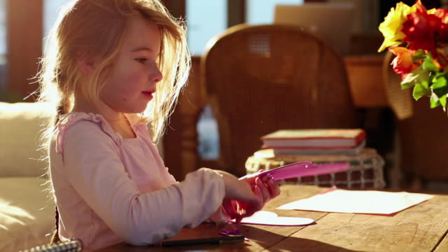 MS Young girl doing arts and crafts in her home / Lamy, New Mexico, United States