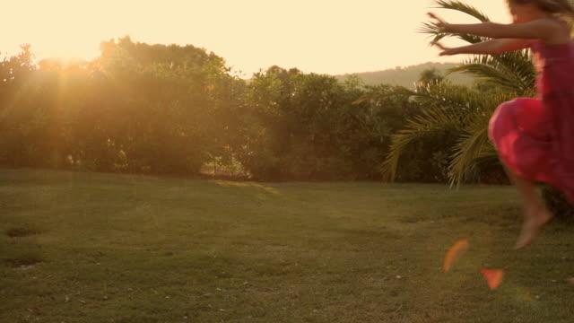 young girl doing cartwheel in sunset - cartwheel stock videos & royalty-free footage