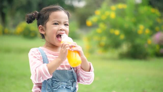 young girl drinking orange juice - orange juice stock videos & royalty-free footage