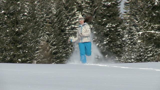 hd: young girl enjoy snowshoeing. - pokljuka stock videos and b-roll footage