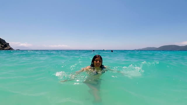 young girl enjoying on amazing blue sea - only teenage girls stock videos and b-roll footage
