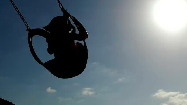 young girl enjoying swinging - tyre swing stock videos & royalty-free footage