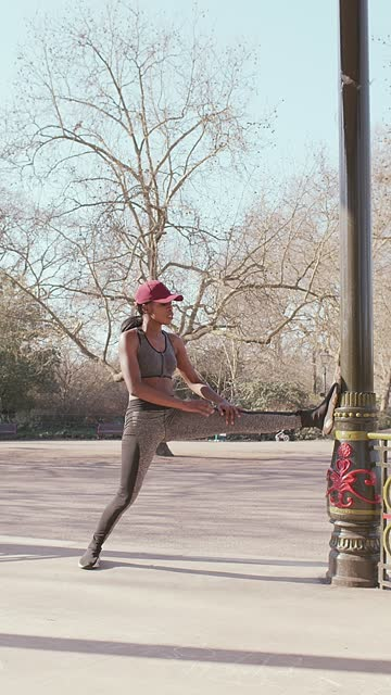 young girl exercising at the bandstand - cap stock videos & royalty-free footage