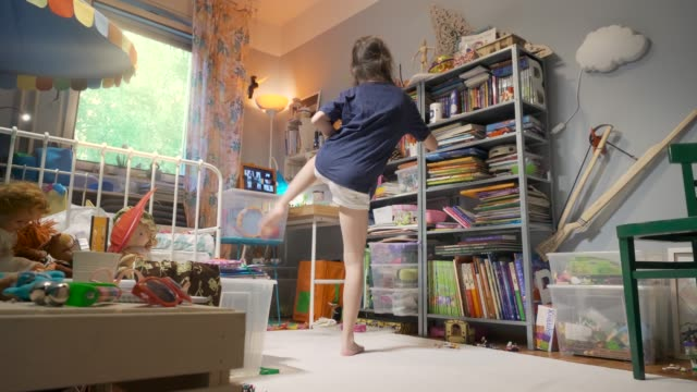 young girl exercising through video conference in her room during during the coronavirus covid-19 crisis pandemic lockdown - bodyweight training stock videos & royalty-free footage