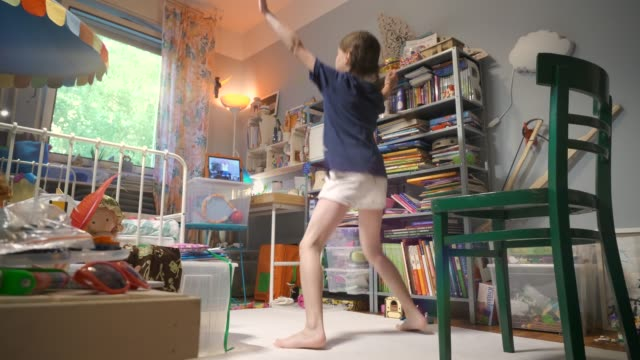 young girl exercising through video conference in her room during during the coronavirus covid-19 crisis pandemic lockdown - children only stock videos & royalty-free footage