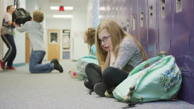 Young Girl Experiencing Anxiety as Bullying Occurs in Background