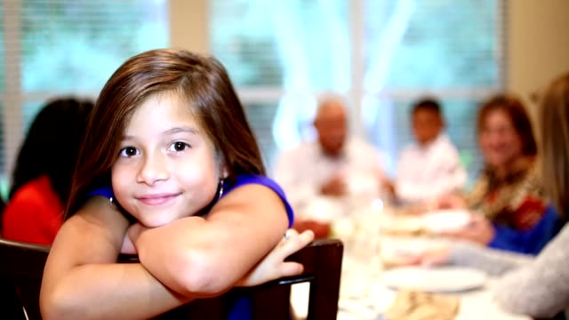 young girl, family at thanksgiving dinner table. - christmas meal stock videos & royalty-free footage