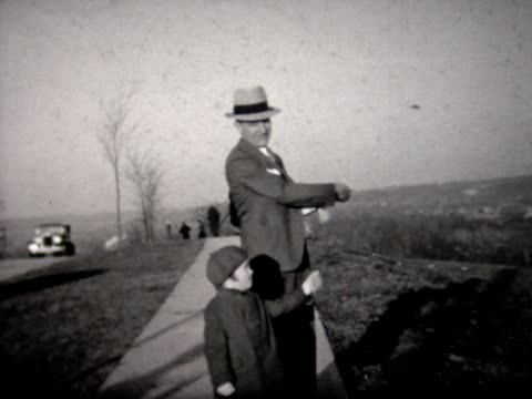 1935 young girl flying kite with dad - 1935 stock videos & royalty-free footage