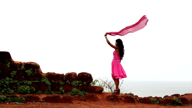 young girl flying scarf standing on chapora fort, goa - scarf stock videos & royalty-free footage