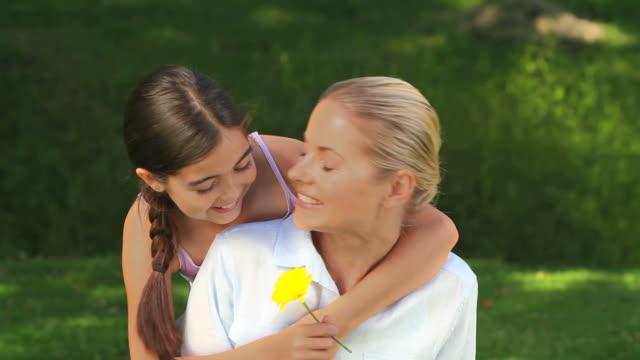 vídeos de stock, filmes e b-roll de young girl giving a flower to her mother / cape town, western cape, south africa - mãos cobrindo olhos