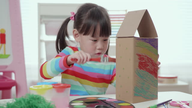 young girl hand makes bird house using shoe box - craft stock videos & royalty-free footage