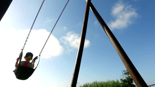 young girl having a fun time on the swing - tyre swing stock videos & royalty-free footage