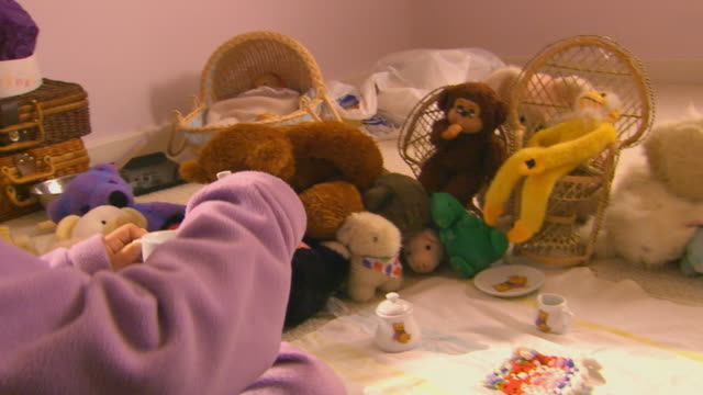 young girl having tea party with stuffed animals - tea party stock videos and b-roll footage