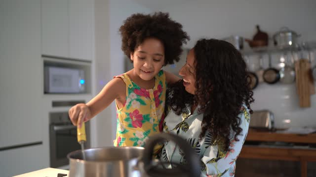 young girl helping mother cooking at home - teaching stock videos & royalty-free footage