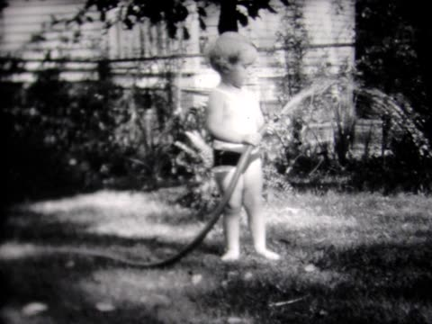 1931 young girl in bathing suit with garden hose - 1931 stock videos & royalty-free footage