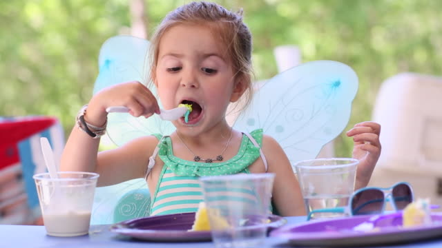 ms young girl in fairy wings eating birthday cake / st simon's island, georgia, united states - üppig allgemein beschreibender begriff stock-videos und b-roll-filmmaterial