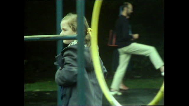a young girl in flares plays in a glasgow park; 1976 - jeans stock videos & royalty-free footage