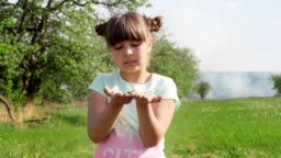 Young girl in nature holding the little butterfly