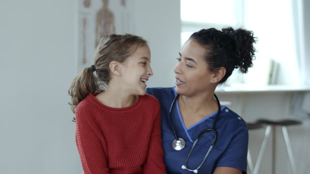 a young girl is comforted by a nurse - human heart stock videos & royalty-free footage