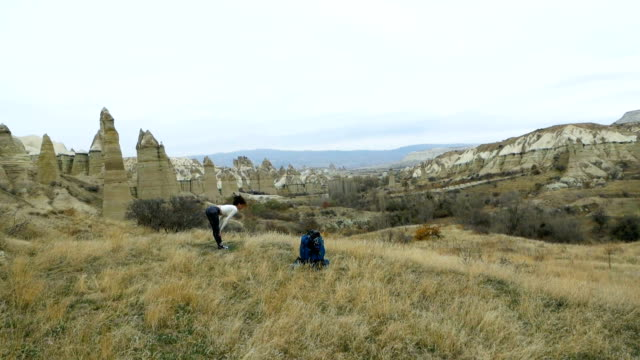 young girl is doing stretching exercises  in the love valley in goreme in cappadocia in turkey - zen like stock videos & royalty-free footage