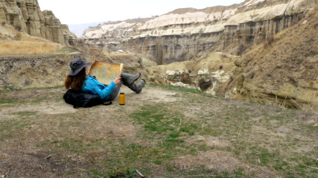 young girl is holding world map in cappadocia guvercilik valley in goreme in turkey - rock hoodoo stock videos & royalty-free footage