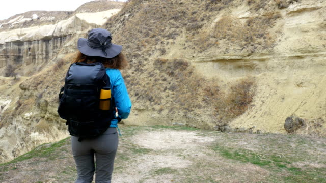 young girl is holding world map in cappadocia guvercilik valley in goreme in turkey - rock hoodoo stock videos and b-roll footage