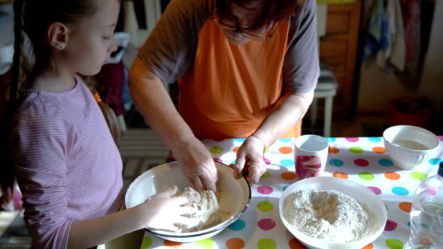 young girl learning to knead dough - rolling pin stock videos & royalty-free footage