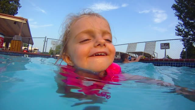 young girl learns to swim in swimming pool - life jacket stock videos & royalty-free footage