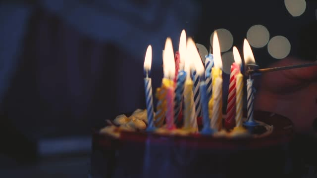 young girl lighting 16 candles on birthday cake - birthday gift stock videos & royalty-free footage