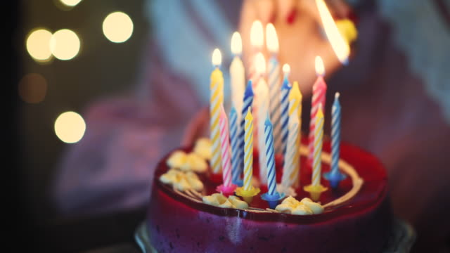 young girl lighting candles on birthday cake - birthday stock videos and b-roll footage