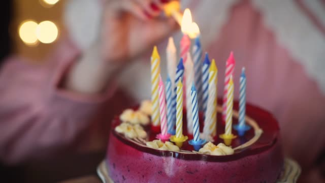 young girl lighting candles on birthday cake - 16 17 years stock videos & royalty-free footage