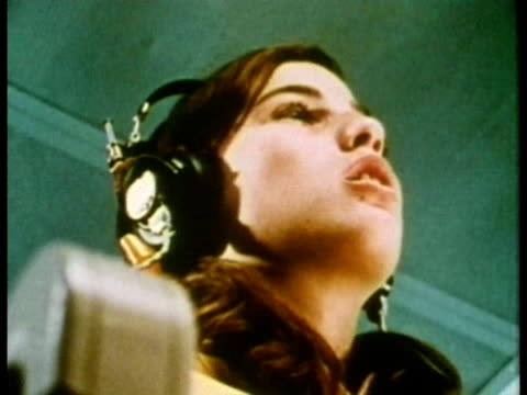 1969 la cu young girl listening with headphones in isolation chamber and repeating specially-selected words during hearing test/ usa/ audio - booth stock videos & royalty-free footage