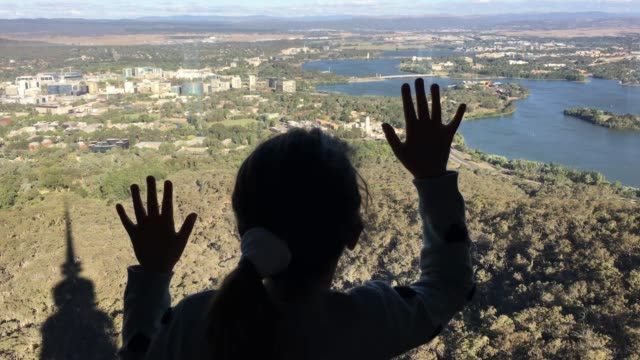 Young Girl Looking at Canberra from Telstra Tower Lookout
