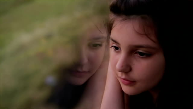 young girl looking out of car window - window stock videos & royalty-free footage