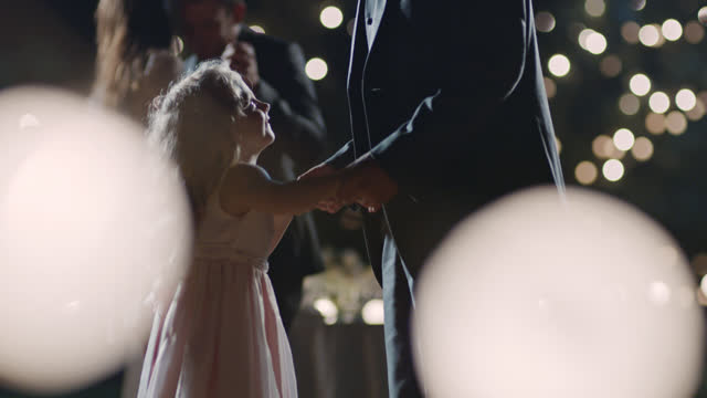slo mo. young girl looks up and smiles as she dances with her father at wedding reception. - love emotion stock videos & royalty-free footage