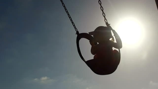 young girl loving being swung on the swing - tyre swing stock videos & royalty-free footage