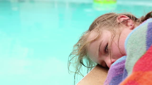 cu young girl lying by side of pool / lamy, new mexico, united states - lamy new mexico stock videos & royalty-free footage