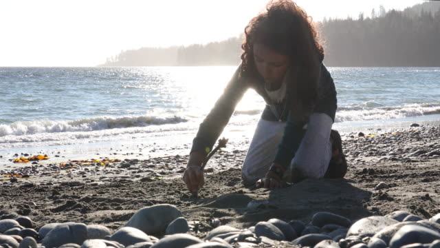 young girl makes beach drawings, in sand - curly stock videos & royalty-free footage
