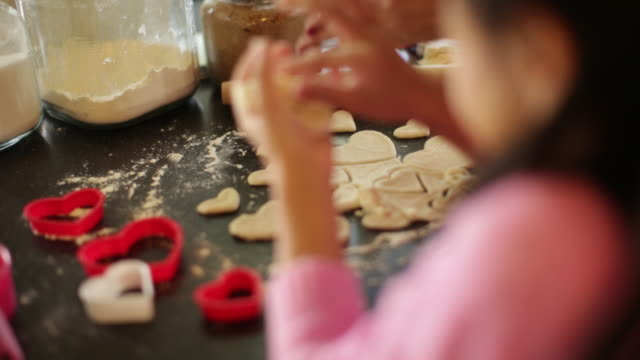 CU Young girl making cookies.